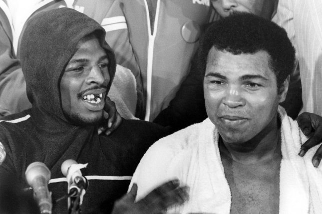 Leon Spinks (left) appears with Muhammad Ali after winning a 15-round split decision at the Las Vegas Hilton Pavilion on February 15, 1978. UPI file photo