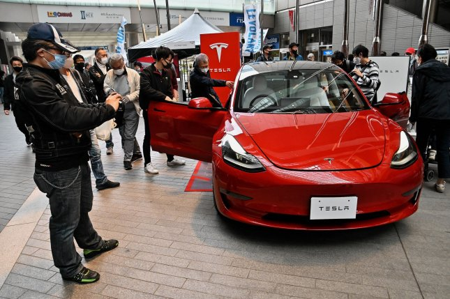 Spectators take photos of the Tesla Model 3 at an event in Tokyo, Japan on March 28, 2021. Lucid Air, which is expected to rival Tesla, announced Monday the opening of its New York City studio and additional plans for its first vehicle, Lucid Air. File photo by Keizo Mori/UPI