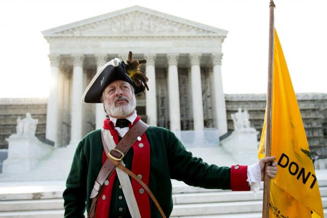 A member of the Tea Party Patriots protests against President Obama's health care reform law in front of the United State Supreme Court on June 28, 2012 in Washington, D.C. UPI/Kevin Dietsch