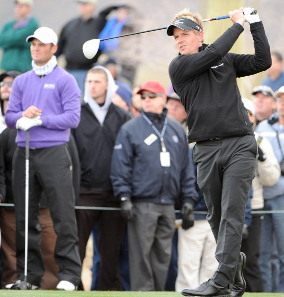 Luke Donald,shown at a tournament last February, owns a share of the lead with Matteo Manasseo and Alvaro Quiros halfway through the European Tour's BMW PGA Championship.. UPI /Art Foxall