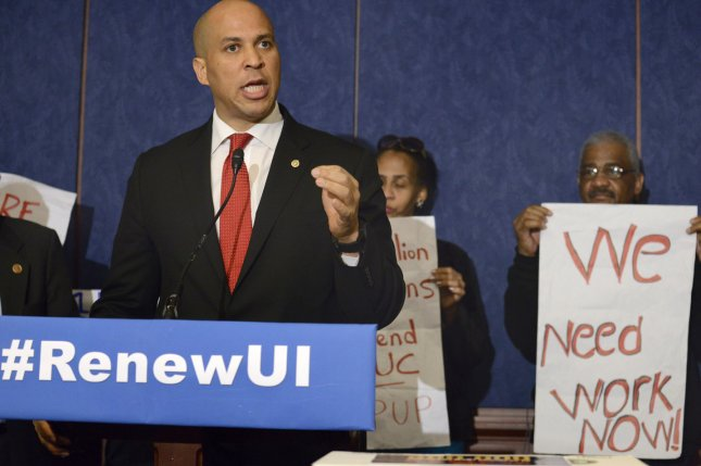 US Sen. Cory Booker (D-NJ) makes remarks at a press briefing on renewing unemployment insurance benefits at the US Capitol, January 16, 2014, in Washington, DC. A new poll gives Booker a 10-point lead over Republican Jeff Bell. UPI/Mike Theiler