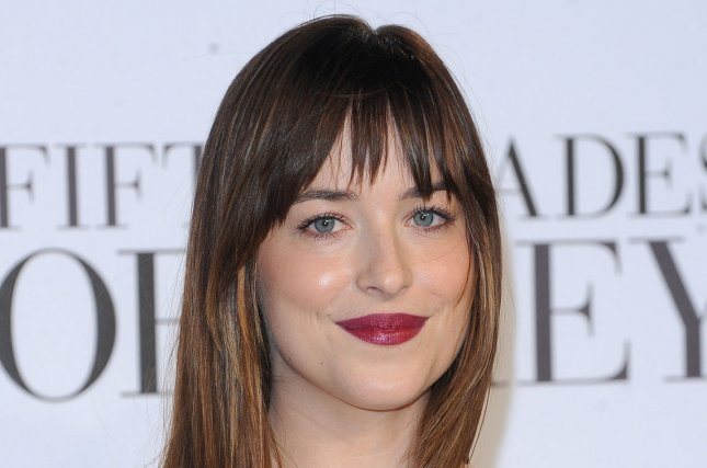 American fashion model and actress Dakota Johnson attends the UK premiere of Fifty Shades of Grey at Odeon Leicester Square in London on Feb. 12, 2015. Photo by Paul Treadway/UPI