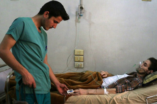 A Syrian medic helps a wounded man in the hospital after alleged Russian airstrikes hit Aleppo, Syria, on May 21 after a cease-fire agreement broke. On Wednesday, another cease-fire agreement was broken as shelling resumed in eastern Aleppo despite efforts to evacuate rebels and civilians. File Photo by Ameer Alhalbi/UPI
