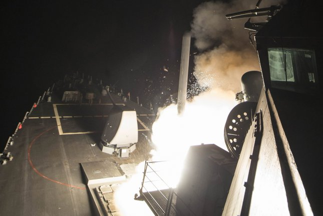 The USS Ross fires a Tomahawk cruise missile on Thursday at an airbase in Syria. Photo by Mass Communication Specialist 3rd Class Robert S. Price/U.S. Navy