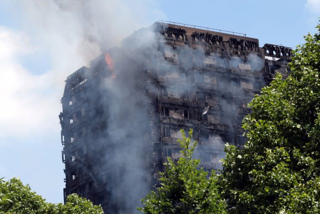 Firefighters respond to a massive fire at the Grenfell Tower, a 24-floor apartment building in north Kensington, London, Britain, on Wednesday. Photo by Hugo Philpott/UPI