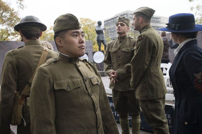 Re-enactors attend the official groundbreaking ceremony for the national World War I Memorial in Washington, D.C., on Thursday. The memorial, designed by 25-year-old architect Joseph Weishaar, will be built into Pershing Park, named for WWI Gen. John Pershing. Photo by Kevin Dietsch/UPI