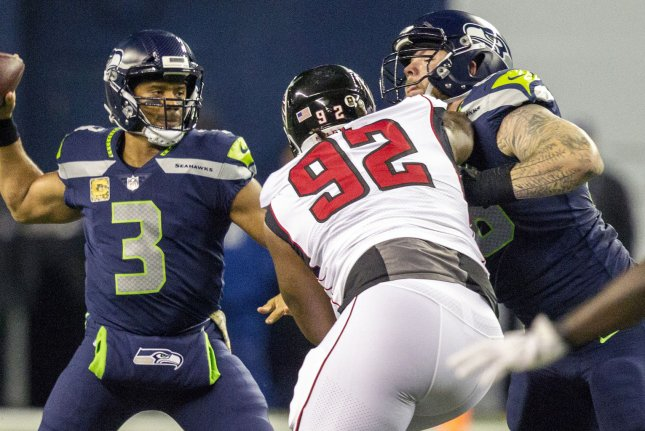 Seattle Seahawks quarterback Russell Wilson (3) gets set to pass while center Justin Britt (68) blocks former Atlanta Falcons defensive tackle Dontari Poe (92) in the third quarter on November 20, 2017 at CenturyLink Field in Seattle, Washington. Photo by Jim Bryant/UPI