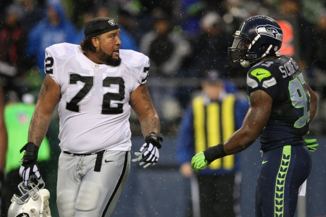 Former Seattle Seahawks defensive end O'Brien Schofield (93) and Oakland Raiders left tackle Donald Penn (72) exchange words with one another during the fourth quarter on November 2, 2014 at CenturyLink Field in Seattle, Washington. File photo by Jim Bryant/UPI