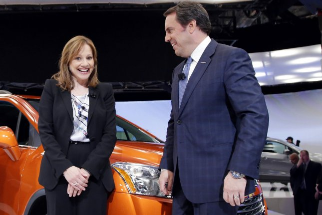 Mark Reuss (R), pictured with General Motors CEO Mary Barra, was named president of General Motors on Thursday. File Photo by John Angelillo/UPI