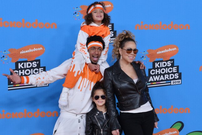 Nick Cannon (L), pictured with Mariah Carey (R) and their children, will host and produce a nationally syndicated talk show for Lionsgate's Debmar-Mercury beginning in 2020. File Photo by Jim Ruymen/UPI
