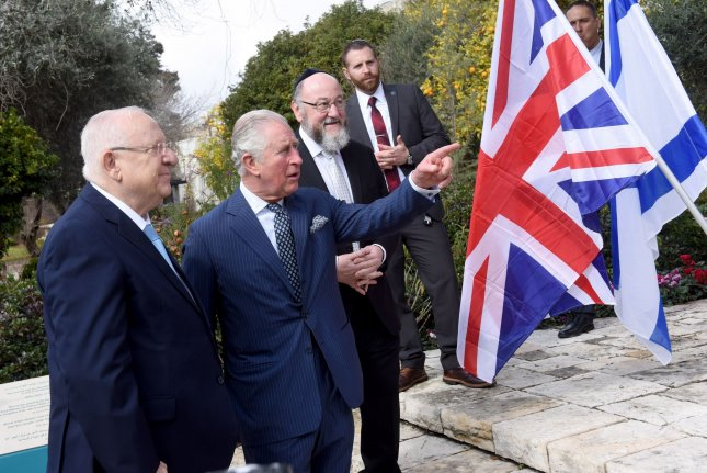 Israeli President Reuven Rivlin (L) and Britain's Prince Charles talk Thursday after planting a tree outside the presidential residence in Jerusalem ahead of the Fifth World Holocaust Forum. Photo by Debbie Hill/UPI