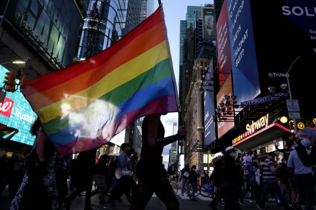 Activists hold rainbow flags during thePeople's March for Roxanne Moore in Times Square along New York City's Seventh Avenue on October 2, 2020. Moore, a 29-year-old Black transgender woman from Reading, Pa., was shot 16 times by police officers. File Photo by John Angelillo/UPI