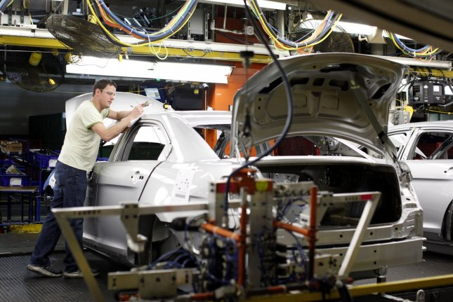A worker inspects a car at the Ford Assembly Plant in Chicago on Jan. 26, 2010. File Photo by Brian Kersey/UPI.