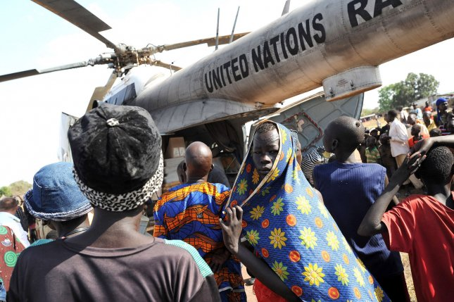 A UN helicopter delivering voting material and aid lands in Sudan. UPI/Tim McKulka/UN