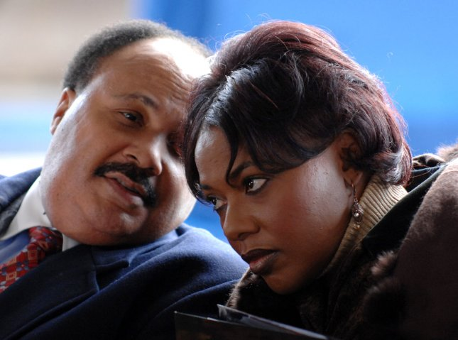 Martin Luther King, III, and his sister, Bernice King, children of Dr. Martin Luther King, Jr., and Coretta Scott King, talk during the service as their parents are interred together in an updated mausoleum unveiled at the King Center in Atlanta on November 20, 2006. Ms. Kings casket was moved from a near-by temporary location on November 17, 2006, to the newly-constructed mausoleum 10 months after her death. Dr. King was assassinated in 1968. (UPI Photo/John Dickerson) .