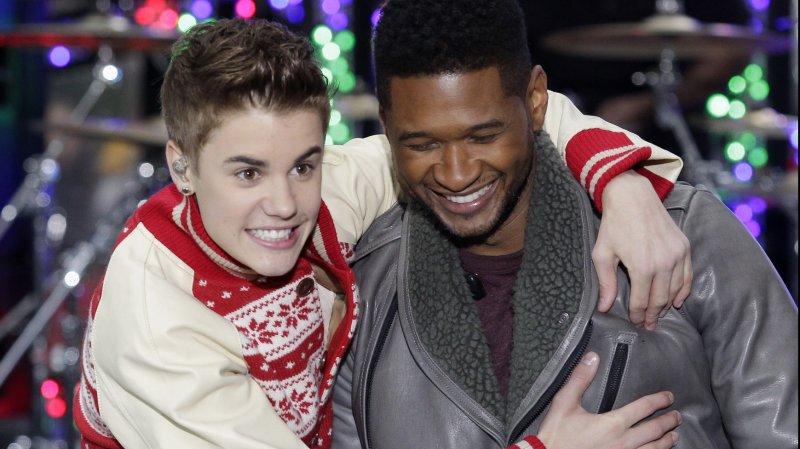 Justin Bieber and Usher UPI File/John Angelillo