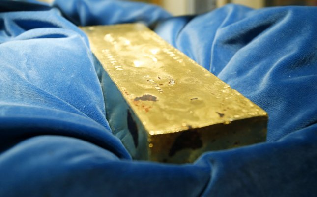 A gold bar from the treasure on the SS Central America, which sank in 1857, was displayed at the Winter Antiques Show in New York in 2013. Tommy Thompson, who found tine wreck in the late 1980s, is under arrest in Florida. File Photo by John Angelillo/UPI