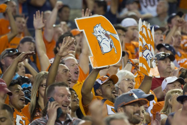 Fans celebrate Denver Broncos defense. Photo by Gary C. Caskey/UPI