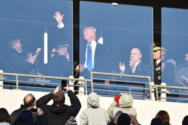 President-elect Donald Trump waves from the Navy stands during the first half Sunday of the annual Army versus Navy rivalry football game at M&T Bank Stadium in Baltimore. Also Saturday, he was interviewed on Fox News Sunday. Photo by David Tulis/UPI