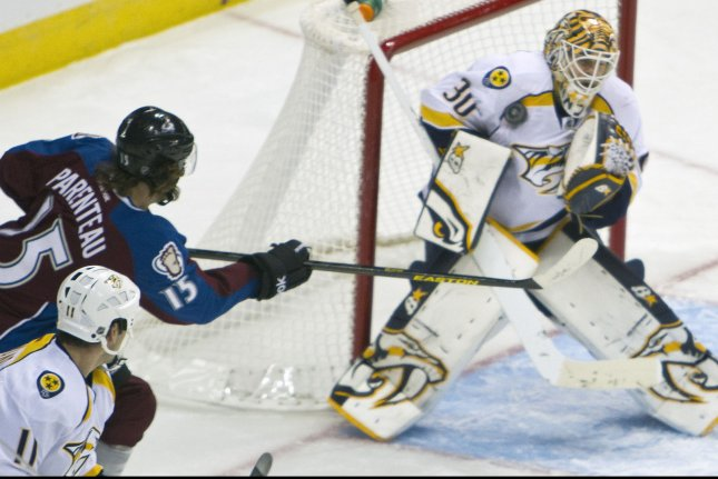 Nashville Predators goalie Chris Mason (30) makes a save against Colorado Avalanche right wing PA Parenteau during the first period at the Pepsi Center on February 18, 2013 in Denver. UPI/Gary C. Caskey