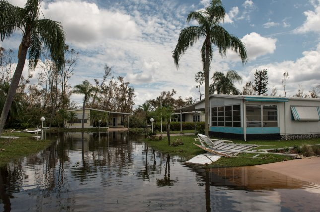 Debris from mobile homes lay on the ground in a mobile home park in Naples, Fla., on Wednesday. President Donald Trump visited the park Thursday. Photo by Ken Cedeno/UPI