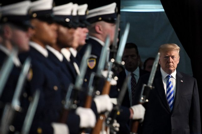 U.S. President Donald Trump participates in the U.S. Coast Guard change-of-command ceremony Friday at USCG Headquarters in Maryland. Photo by Olivier Douliery/UPI