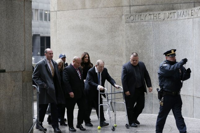 Embattled film producer Harvey Weinstein arrives for a hearing with a walker at Manhattan Supreme Court Wednesday, where he bail was increased.  Photo by John Angelillo/UPI