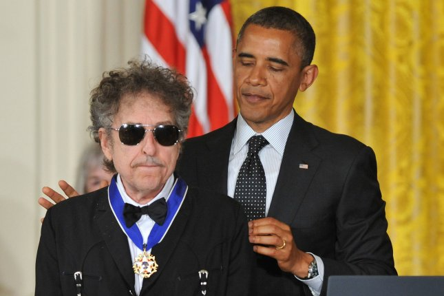 President Barack Obama awards the the Presidential Medal of Freedom to singer/songwriter Bob Dylan during a ceremony in the East Room at the White House in Washington on May 29, 2012. Dylan has sold his song catalog to Universal Music Publishing Group. File Photo by Kevin Dietsch/UPI