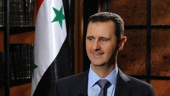A handout picture made available by the state-run Syrian Arab News Agency (SANA), shows President Bashar al-Assad speaking during an interview with the Iranian state television broadcast in Damascus, Syria, on June 28, 2012. UPI