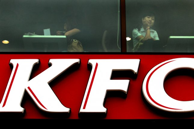 A Chinese woman stares out of a Kentucky Fried Chicken (KFC) in Beijing on July 23, 2012. (File/UPI/Stephen Shaver)