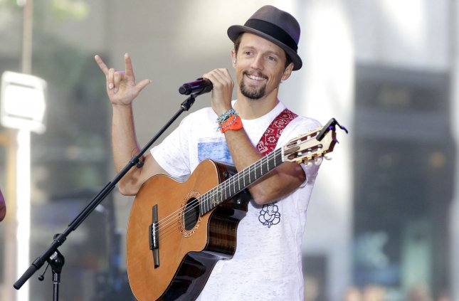 Jason Mraz performs on the NBC Today Show at Rockefeller Center in New York City on July 18, 2014. Mraz shared a video on Twitter teasing a big announcement for fans scheduled this upcoming Thursday. File Photo by John Angelillo/UPI