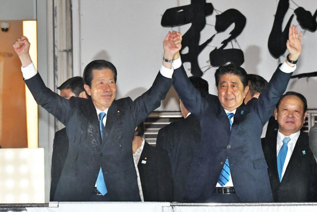Japan's Prime Minister Shinzo Abe raises his fists with coalition partner Komeito Party leader Natsuo Yamaguchi as campaigning for next month's snap election began. Photo by Keizo Mori/UPI