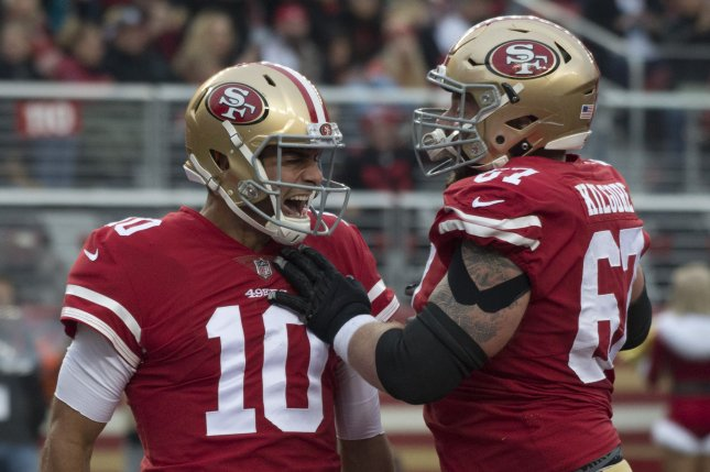 2efd25cf0d8 San Francisco 49ers quarterback Jimmy Garoppolo (10) celebrates with center  Daniel Kilgore after scoring a one-yard touchdown against the Jacksonville  ...