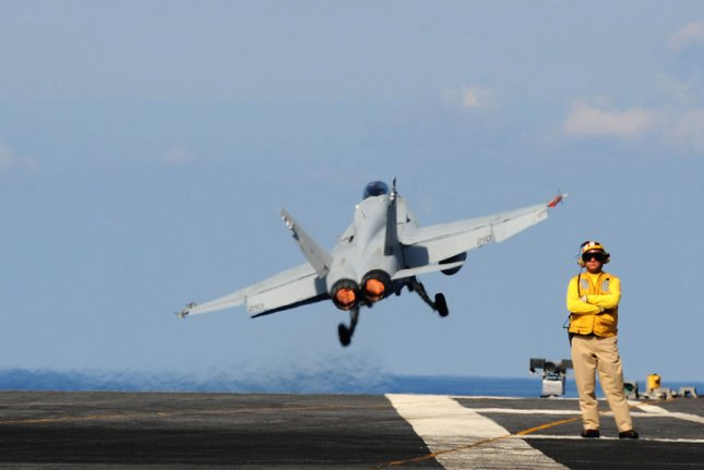 An F/A-18 Hornet, assigned to Marine Fighter Attack Squadron 312, launches off the flight deck of USS Harry S. Truman on September 15, 2009. The Navy has exercised a contract option with General Electric for work on engines in the aircraft. File photo by Matthew Williams/U.S. Navy/UPI