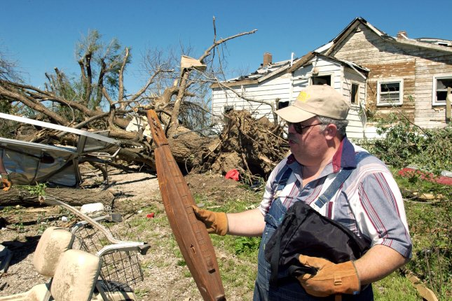 Darrell Roderick of Kansas City, Mo., helped salvage items from his mother-in-law's property May 5, 2003, after a tornado tore through the area the night before. File Photo by Todd Feeback/UPI