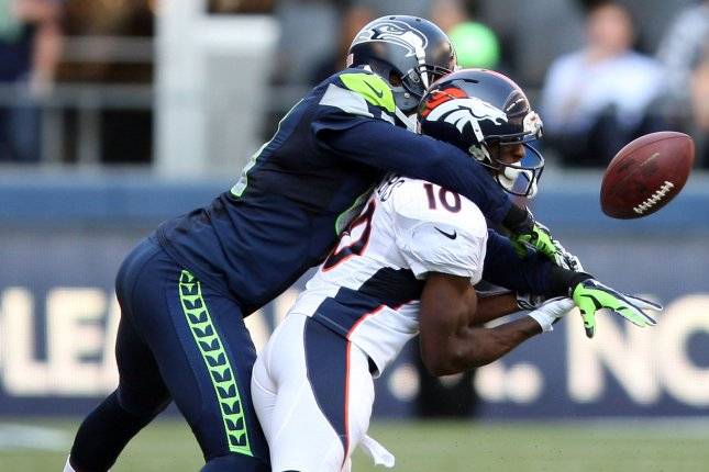 Seattle Seahawks cornerback Byron Maxwell (41) breaks up a pass intended for Denver Broncos wide receiver Emmanuel Sanders. File photo by Jim Bryant/UPI