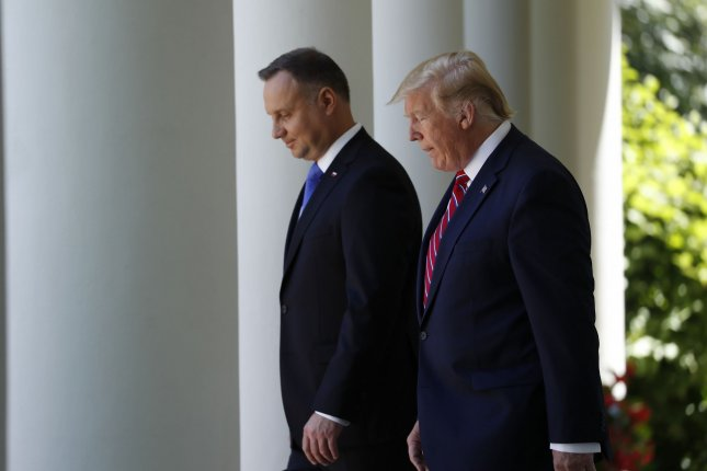 U.S. President Donald Trump and Polish President Andrzej Duda walk along the White House colonnade during a visit by Poland's leader on June 12. File Photo by Shawn Thew/Pool/UPI