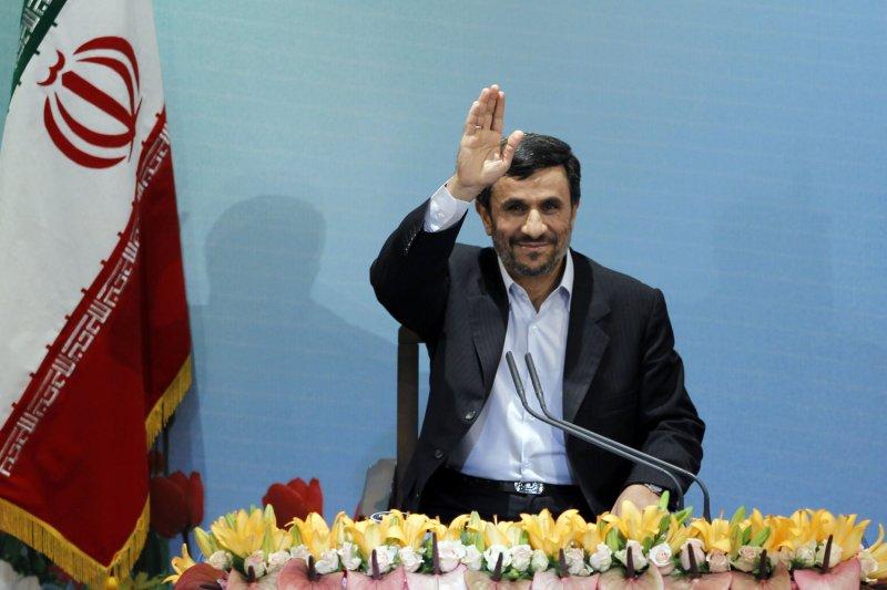 Iranian President Mahmoud Ahmadinejad waves to the media before his press conference in presidential palace in Tehran, Iran on April 4, 2011. UPI/Maryam Rahmanian