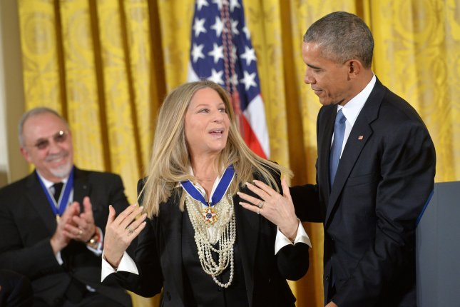 President Barack Obama awards the Medal of Freedom to singer Barbra Streisand on Tuesday during a ceremony at the White House. Photo by Kevin Dietsch/UPI