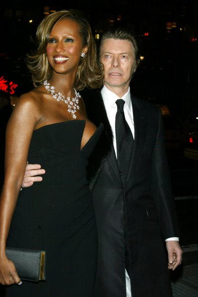 David Bowie and wife Iman pose for pictures at the amfAR Gala honoring Richard Gere, Lorne Michaels and Anna Wintour at Cipriani in New York City in 2003. A single lock of Bowie's blond hair sold at auction over the weekend for $18,750. File Photo by lc/Laura Cavanaugh/UPI
