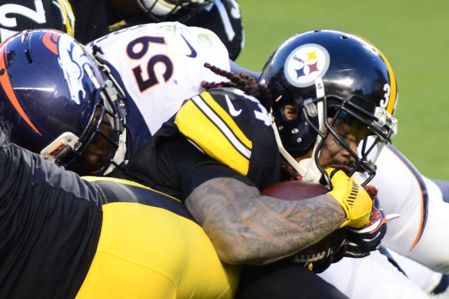 Pittsburgh Steelers running back DeAngelo Williams (34) scores a touchdown in the first quarter as Denver Broncos inside linebacker Danny Trevathan (59) attempts to make the stop at Heinz Field in Pittsburgh on December 20, 2015. Photo by Archie Carpenter/UPI