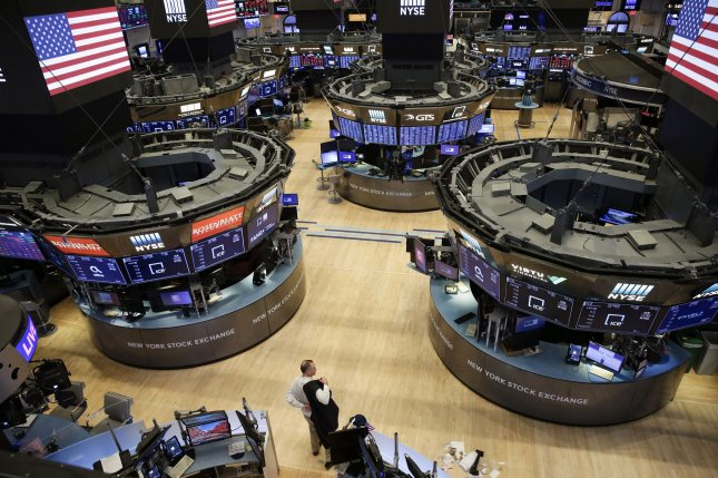 A mostly empty trading floor is seen on March 20 at the New York Stock Exchange on Wall Street in New York City, its final day before it went to all-electronic trading for the first time in its history. The trading floor will reopen to a limited number of brokers on May 26. File Photo by John Angelillo/UPI