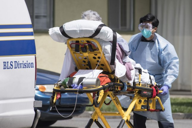 An elderly patient is moved out of a care facility in Hayward, Calif., on April 9. Dozens of patients and staffers there had tested positive for COVID-19 and several patients died of the disease. File Photo by Terry Schmitt/UPI