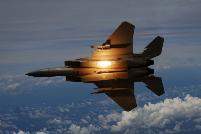 A U.S. Air Force F-15C Eagle aircraft from the 44th Fighter Squadron out of Kadena Air Base, Japan, releases a flare over Okinawa, Japan, July 22, 2009, during a total solar eclipse. File Photo by Airman 1st Class Chad Warren/U.S. Air Force
