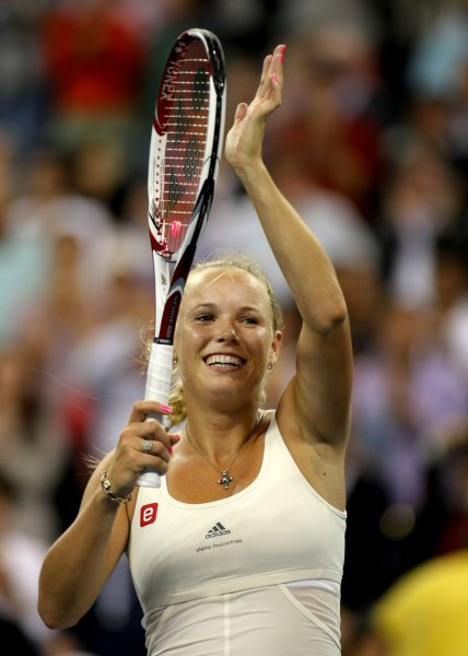 Caroline Wozniacki, shown after a match win at the 2011 U.S. Open, was pushed to three set but won a second-round match Tuesday at the Toray Pan Pacific Open in Tokyo. UPI/Monika Graff