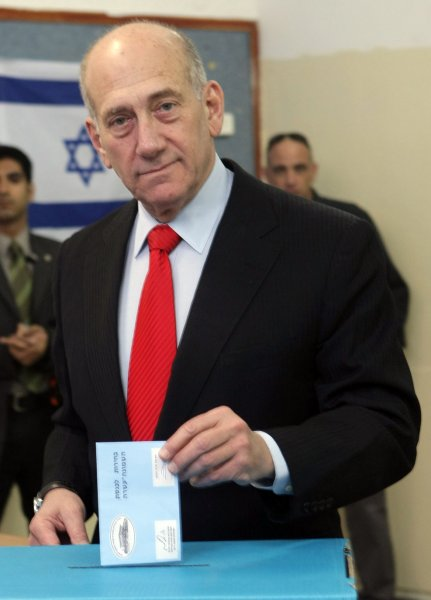 Israeli Prime Minister Ehud Olmert from the centrist Kadima party casts his ballot at a polling station in the national election in Tel Aviv on February 10, 2009. Likud Party leader Benjamin Netanyahu and Kadima Party leader, Tzipi Livni, are in a tight race to be Israel's next leader. (UPI Photo/Kobe Gideon/Pool)