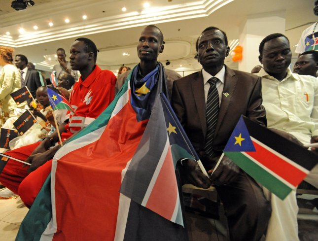 A Southern Sudanese refugee wears a South Sudan flag during independence celebrations in Tel Aviv, Israel, July 10, 2011. Israeli Prime Minister Benjamin Netanyahu announced Sunday that Israel will recognize South Sudan as an independent state. UPI/Debbie Hill