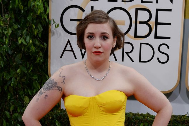 Actress Lena Dunham arrives for the 71st annual Golden Globe Awards at the Beverly Hilton Hotel in Beverly Hills, California on January 12, 2014. UPI/Jim Ruymen