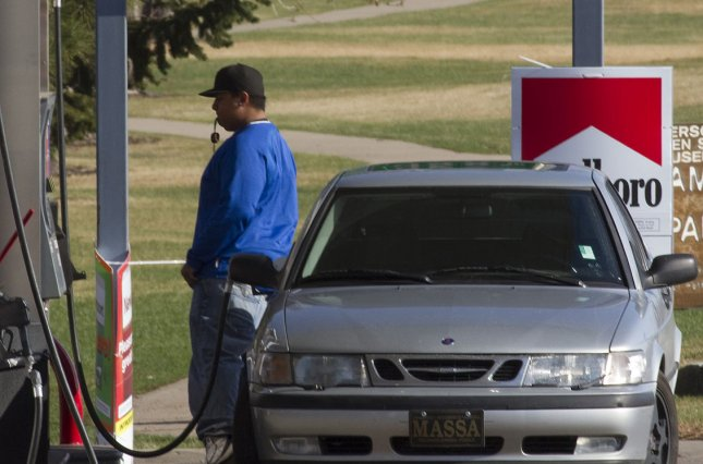 Pumps at gas stations in Berkeley, California, could soon feature global warming warning stickers. UPI/Gary C. Caskey