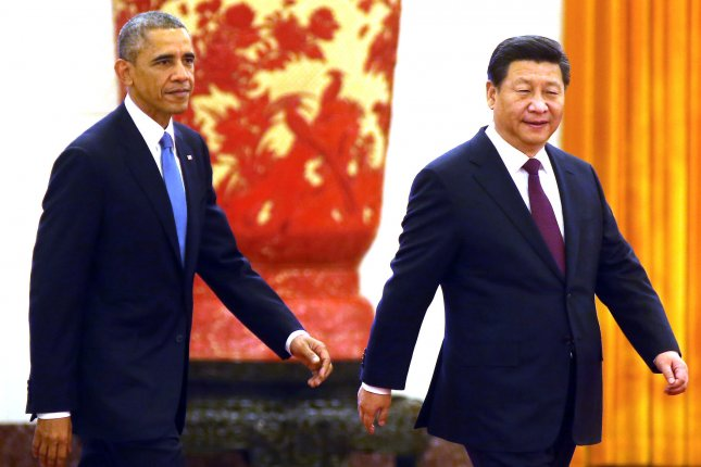 U.S. President Barack Obama, left, and Chinese President Xi Jinping attend a welcoming ceremony at the Great Hall of the People in Beijing on Nov. 12, 2014. File Photo by Stephen Shaver/UPI